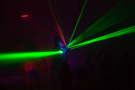 Colorful lights show. Laser show in motion in dark. Stok Fotoğraf