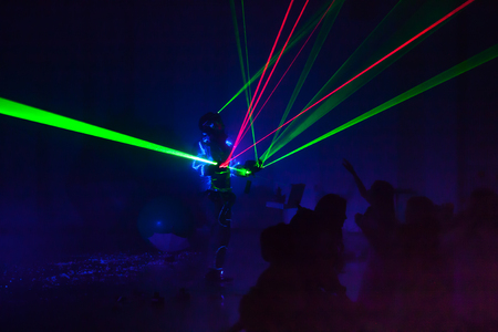 Colorful lights show. Laser show in motion in dark. Imagens