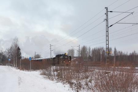 KOUVOLA, FINLAND - DECEMBER 26, 2018: Steam train Ukko-Pekka going from Kouvola to Kotka. The steam locomotive Hr1 1009 was made in 1948 and restored in 1993.
