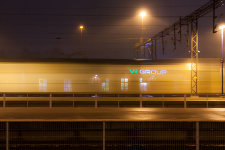 KOUVOLA, FINLAND - NOVEMBER 7, 2018: Train in motion on the station at night, long exposure photo