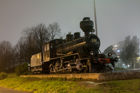KOUVOLA, FINLAND - NOVEMBER 7, 2018: Old steam locomotive as an exhibit at the Kouvola railway station in Finland at night