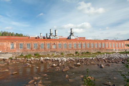 KOUVOLA, FINLAND - SEPTEMBER 20, 2018: Hydroelectric power generation plant and Ankkapurha Industrial Museum at Kymijoki river, Finland. 報道画像
