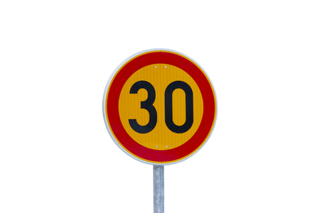 Speed limit 30 kilometers per hour road sign on pole isolated on white background.