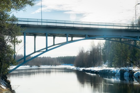 Spring landscape of bridge and Kymijoki river waters in Finland, Kymenlaakso, Kouvola, Myllykoski