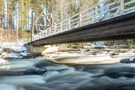 Long exposure photo. Dam and threshold on the river Jokelanjoki, Kouvola, Finland
