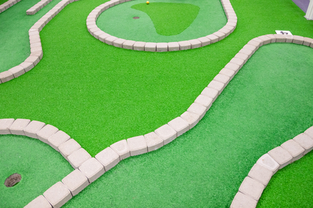 Mini golf court in children activity park. Imagens