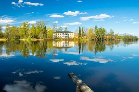 Kouvola, Finland - May 16, 2019: Beautiful wooden Rabbelugn Manor - Takamaan Kartano. Wrede family house was built in 1820 on the river Kymijoki bank. Редакционное