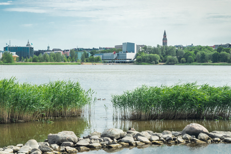 Helsinki, Finland - June 12, 2019: Toolo bay in the City Park in Helsinki, Finlandia Hall congress and event venue can be seen across the water Editorial