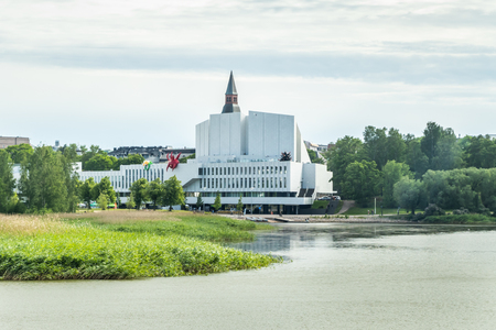 Helsinki, Finland - June 12, 2019: Toolo bay in the City Park in Helsinki, Finlandia Hall congress and event venue can be seen across the water