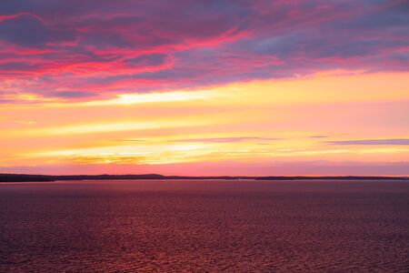Beautiful sunset with clouds over lake Nasijarvi in Tampere, Finland