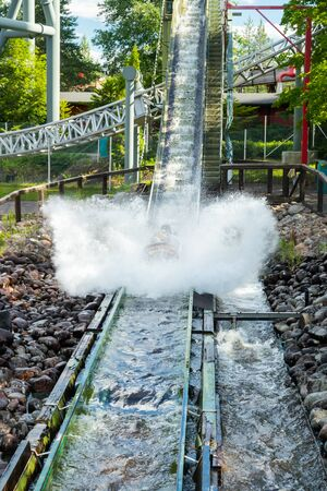 Fun water ride Log river in amusement park at summer 免版税图像