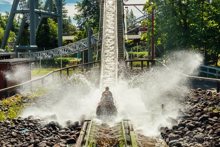 Fun water ride Log river in amusement park at summer Imagens