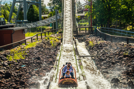 Tampere, Finland - 24 June 2019: Fun water ride Log river in amusement park Sarkanniemi at summer