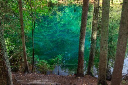 Mystically turquoise coloured spring Kiikunlahde in Hollola, Finland
