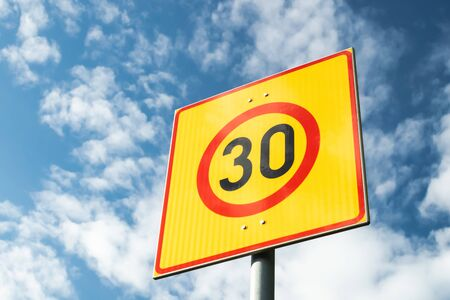 Finnish speed limit sign 30 km h on blue sky background Standard-Bild