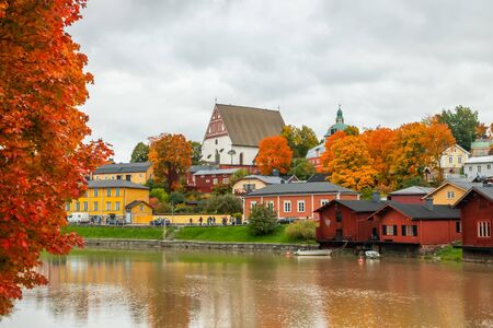 Porvoo, Finland - 2 October 2019: View of old Porvoo, Finland. Beautiful city autumn landscape with Porvoo Cathedral and colorful wooden buildings. Banco de Imagens