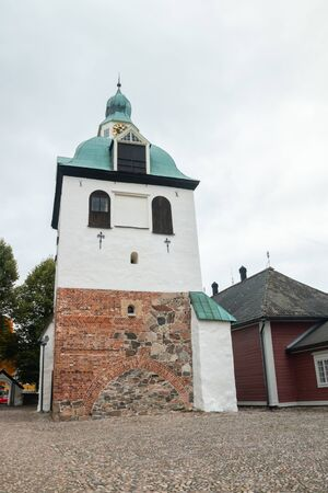 Bell tower of Porvoo Cathedral at autumn.