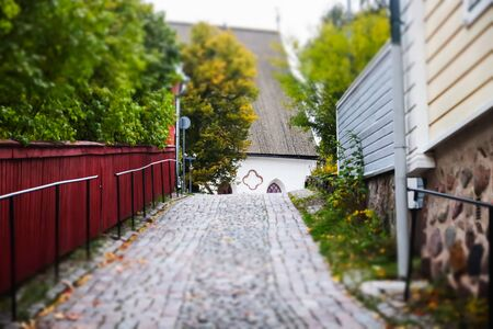 Street of Old Porvoo, Finland. Beautiful city autumn landscape with Porvoo Cathedral and colorful wooden buildings. Banco de Imagens