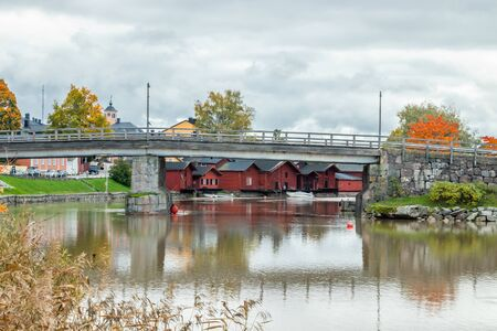 View of old Porvoo, Finland. Beautiful city autumn landscape with bridge and colorful wooden buildings.