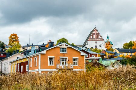 View of old Porvoo, Finland. Beautiful city autumn landscape with Porvoo Cathedral and colorful wooden buildings.