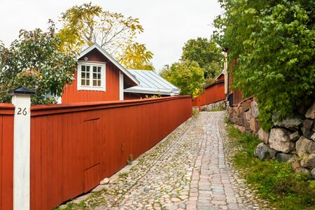 Street of Old Porvoo, Finland. Beautiful city autumn landscape with colorful wooden buildings.