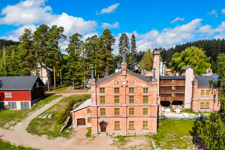 Kouvola, Finland - 2 September 2019: Aerial photo of Verla Mill museum Groundwood and Board Mill at Jaala, is a well preserved 19th century mill village and a UNESCO World Heritage site. 新聞圖片