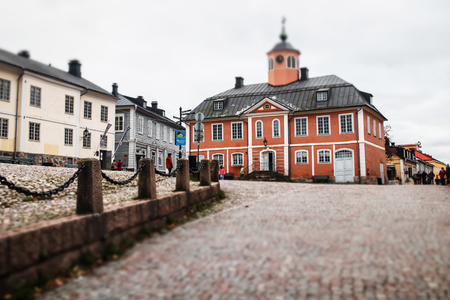 Porvoo, Finland - 2 October 2019: Street of Old Porvoo, Finland. Beautiful city autumn landscape with Old Town Hall.