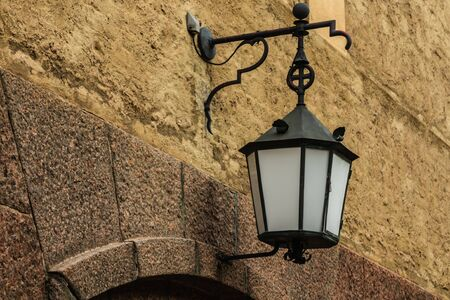 Old lantern hanging on a stone wall of Kuusankoski church, Finland Stock fotó
