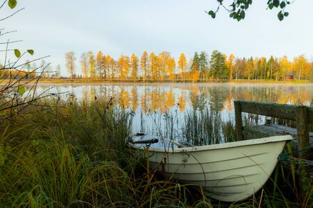 Beautiful autumn morning landscape with old rowing boat and Kymijoki river waters. Finland, Kymenlaakso, Kouvola Stock fotó