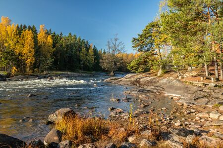Beautiful autumn landscape on river Kymijoki near the Emperor Alexander lll fishing lodge Langinkoski. Kotka, Finland