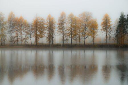 Beautiful autumn landscape of Kymijoki river waters in fog. Finland, Kymenlaakso, Kouvola