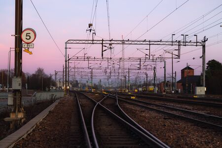 Railway yard at beautiful sunset background in Kouvola, Finland.