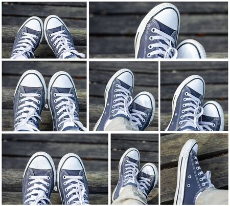 Set of blue sneakers on the feet on wooden background. Top view. Stock fotó