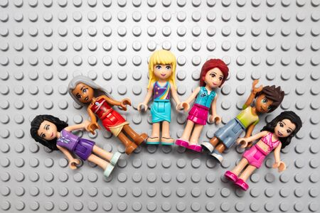 Kouvola, Finland - 18 December 2019: Lego Friends minifigures on gray baseplate
