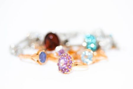 Collection of jewelry with beautiful golden ring with purple stone isolated on white background