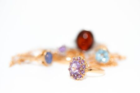 Collection of jewelry with beautiful golden ring with purple stone isolated on white background Archivio Fotografico