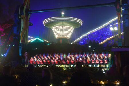 Rides in motion at the amusement park, night illumination. Long exposure.