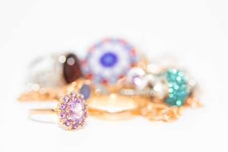Collection of jewelry with beautiful golden ring with purple stone isolated on white background Stock Photo