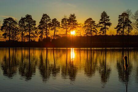 Beautiful sunset on river Kymijoki in February, Finland. Standard-Bild