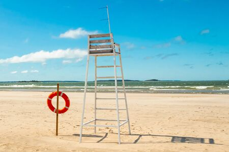 Lifeguard tower and lifering on beautiful sandy beach Yyteri at summer, in Pori, Finland Фото со стока