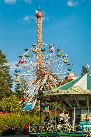 Kouvola, Finland - 10 August 2019: Ride Star Flyer in motion on cloudy sky background in amusement park Tykkimaki