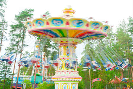 Kouvola, Finland 7 June 2016 - Ride Swing Carousel in motion in amusement park Tykkimaki Редакционное