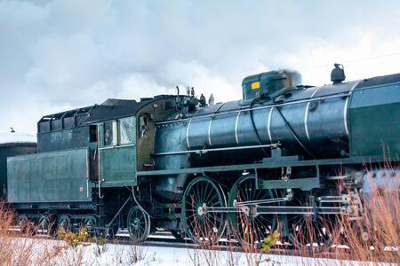 Old retro steam train at winter morning in Finland.