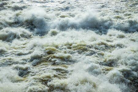 Splashing water waves on the spring fast river