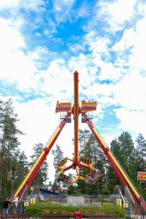 Kouvola, Finland 7 June 2016 - Ride Loop Fighter in motion in amusement park Tykkimaki Редакционное
