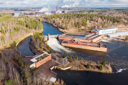 Aerial view of hydroelectric power generation plant and Ankkapurha Industrial Museum at Kymijoki river, Finland. Редакционное