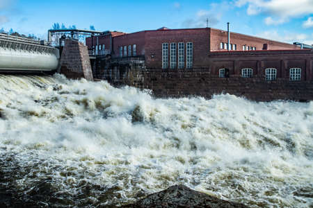 Hydroelectric power generation plant and Ankkapurha Industrial Museum at Kymijoki river, Finland. Banco de Imagens