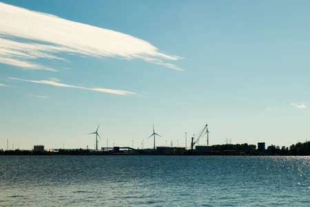 Windmills on island Mussalo in Baltic Sea at sunset, Kotka, Finland