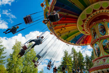 Kouvola, Finland - 14 July 2020: Ride Swing Carousel in amusement park Tykkimaki at summer sunny day
