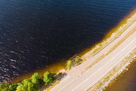 Aerial view of road on Pulkkilanharju Ridge at lake Paijanne, Paijanne National Park, Finland. 版權商用圖片